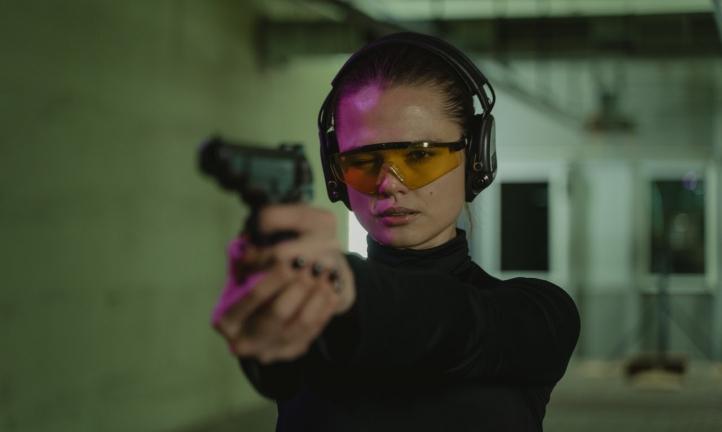 a woman at a shooting range